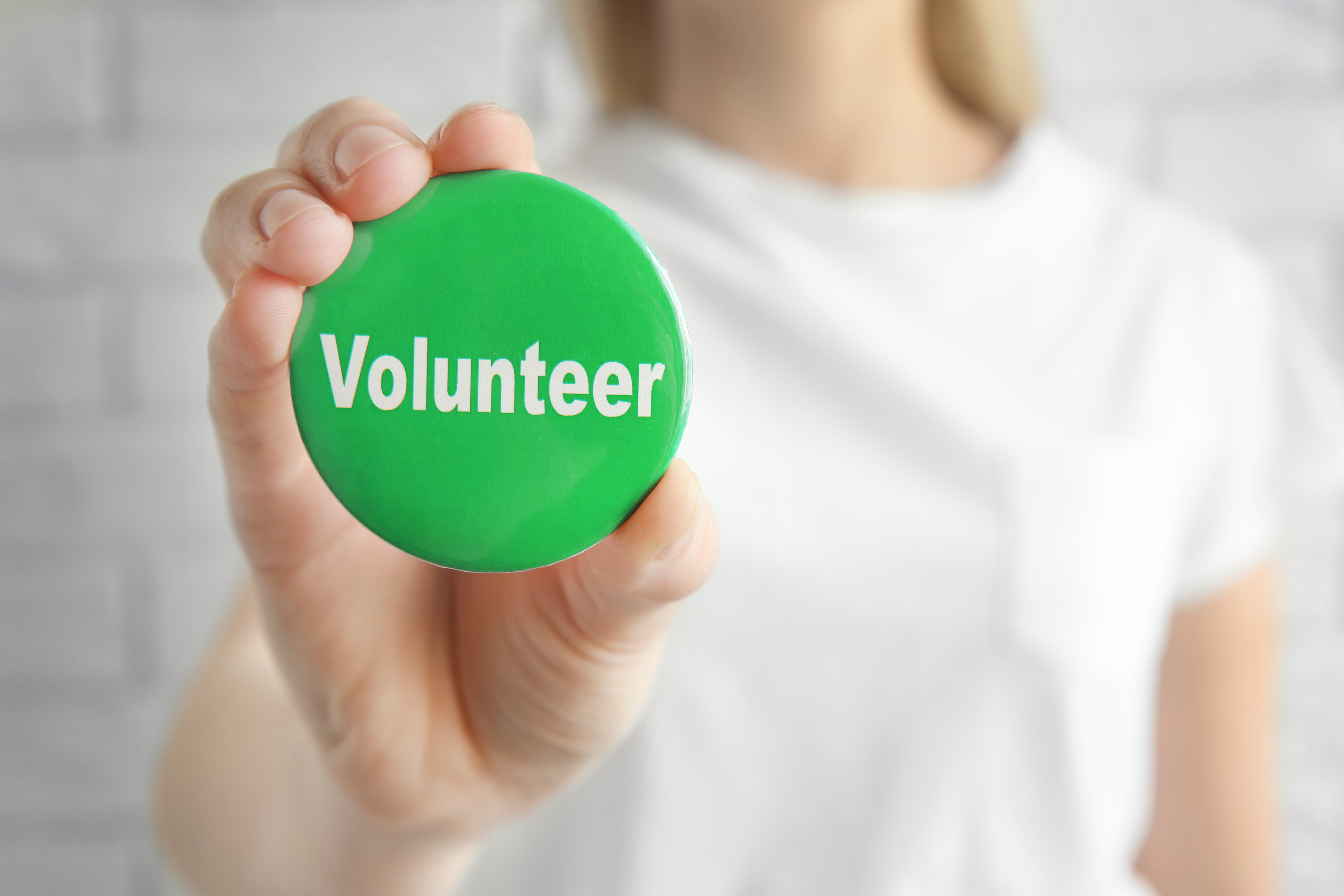 volunteer with button